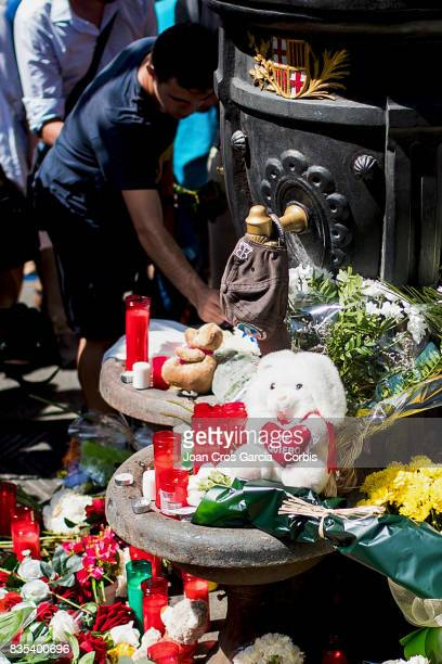 People leaving flowers candles and messages in the emblematic Canaletes fountain in Les Rambles the day after the terrorist attack on August 18 2017...