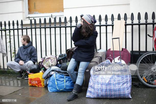 People leaving the pound15 million Grade II listed mansion on Belgrave Place London which has been squatted by the Autonomous Nation of Anarchist...