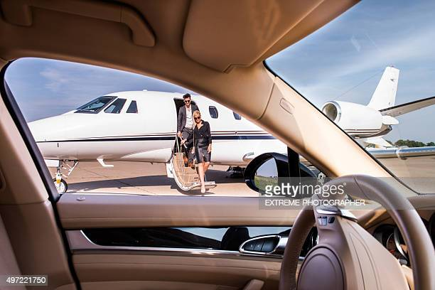 People leaving the private jet aeroplane