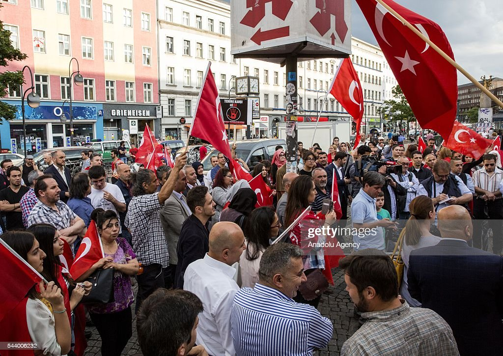 People, led by Turkish NGOs participate a commemoration ceremony, held for the victims of recent Istanbul Ataturk Airport terrorist attack, at Herrmannplatz in Berlin, Germany on June 30, 2016.