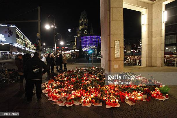 People left flowers and candles at the site near the christmas Market where a lorry truck ploughed through at Breitscheidplatz the day the other...