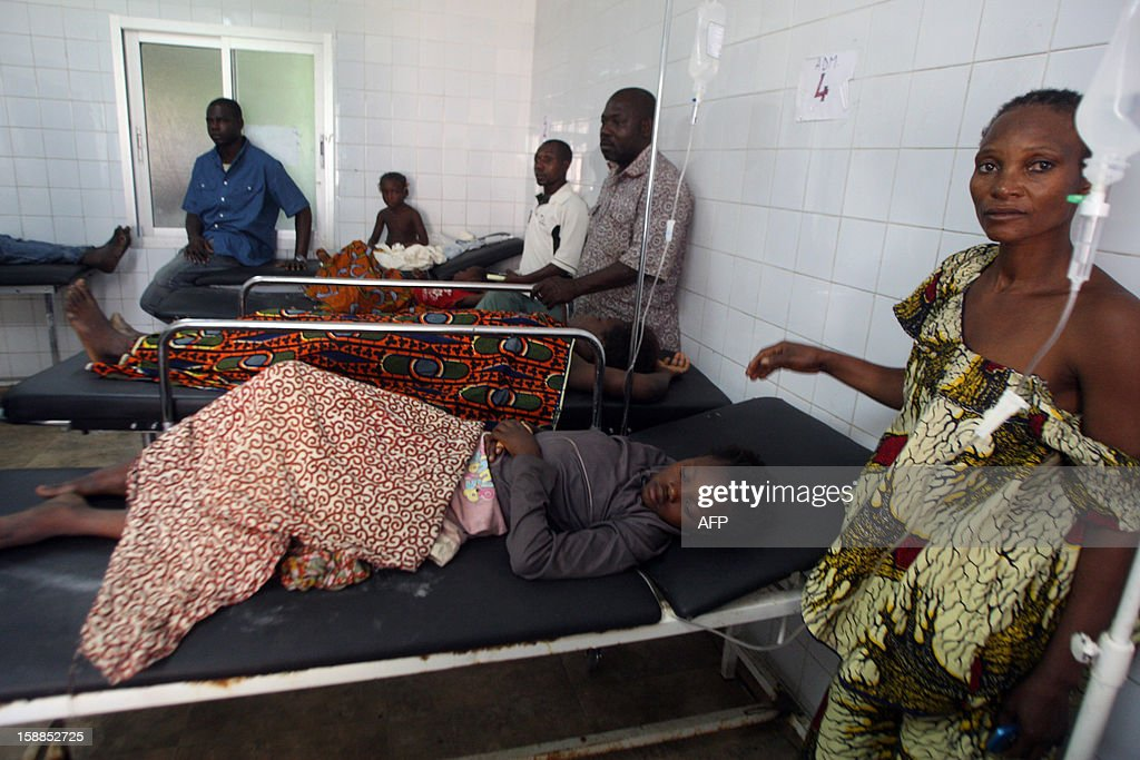 People lie in hospital beds after they were injured in a stampede, at the Cocody hospital in Abidjan, on January 1, 2013. At least 60 people died and at least dozens were injured as crowds stampeded overnight during celebratory New Year's fireworks, Ivory Coast rescue workers said on January 1, 2013. AFP PHOTO/HERVE SEVI