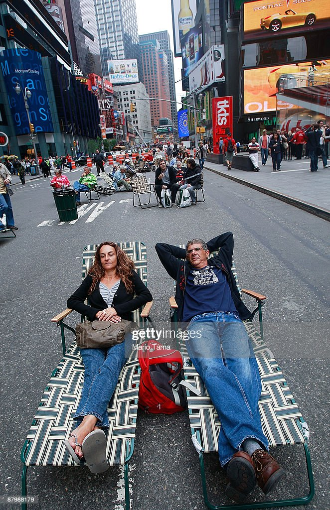 People lie in lounge chairs on Broadway in Times Square after it was converted to a pedestrian zone May 26, 2009 in New York City. Sections of Broadway that pass through Times Square and Herald Square have been closed to vehicles in an effort by the city to reduce traffic and pollution while giving pedestrians more space.