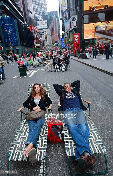 People lie in lounge chairs on Broadway in Times Square after it was converted to a pedestrian zone May 26 2009 in New York City Sections of Broadway...