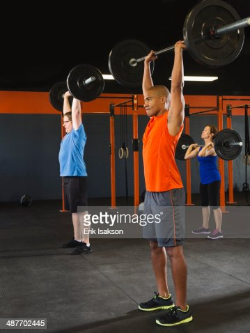 people lifting weights in gym stock photo getty images