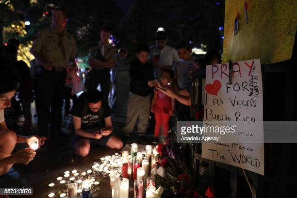 People light candles and leave flowers during memorial for Las Vegas mass shooting victims who lost their lives after a gunman attack in Las Vegas NV...
