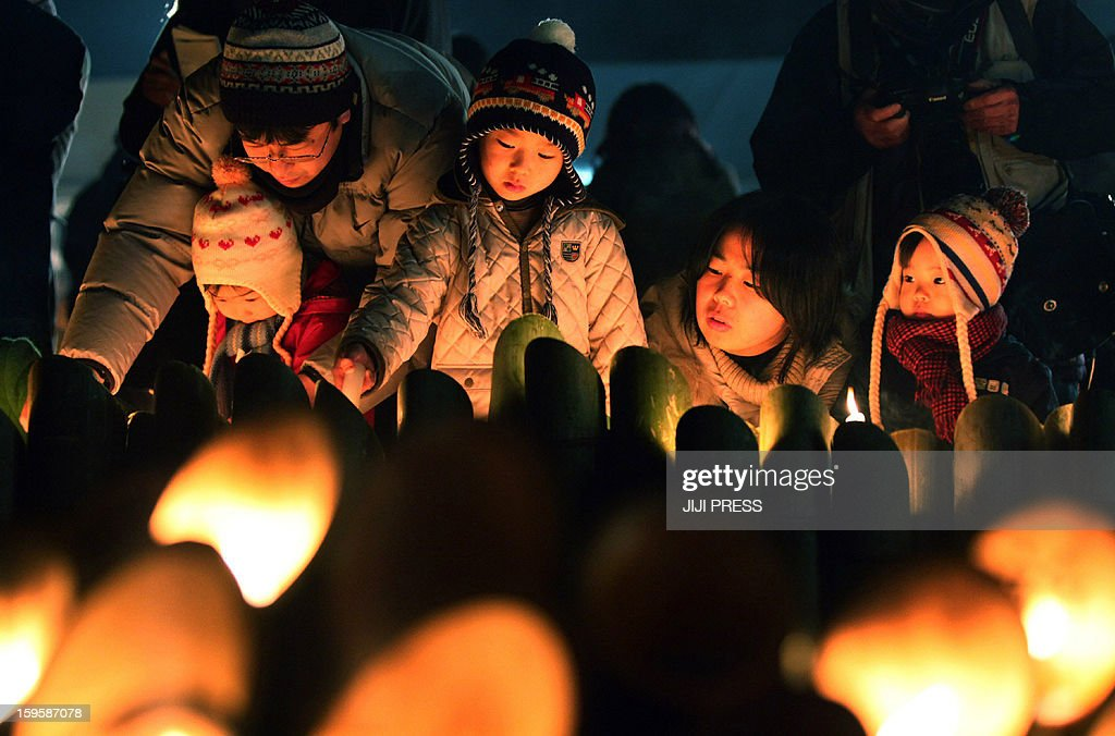 People light candles and pray during a memorial service for the victims of the 1995 'Great Hanshin earthquake', at a park in Kobe, Hyogo prefecture in western Japan on January 17, 2013. Memorial services were held to mark the 18th anniversary of the 1995 massive earthquake, which stuck just before dawn and killed more than 6,400 people. JAPAN