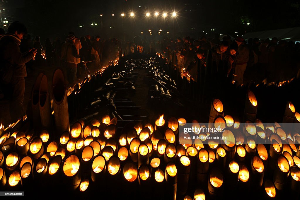 People light candles and pray for victims of the 1995 'Great Hanshin earthquake' during a memorial ceremony on January 17, 2013 in Kobe, Japan. Memorial services were held to mark the 18th anniversary of the 1995 massive earthquake, hundreds of people gathered early this morning to pay their respects and light bamboo lanterns in the park for more than 6,400 people who lost their lives in the 7.3 magnitude earthquake.