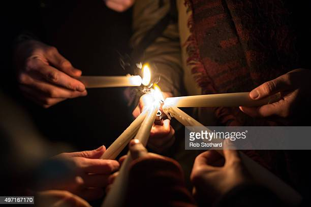 People light candles as they hold a vigil for victims of the Paris terrorist attacks in Trafalgar Square on November 14 2015 in London England...