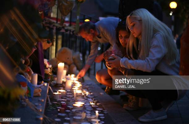 People light candles as they observe a vigil outside Notting hill Methodist Church following the blaze at Grenfell Tower a residential tower block in...