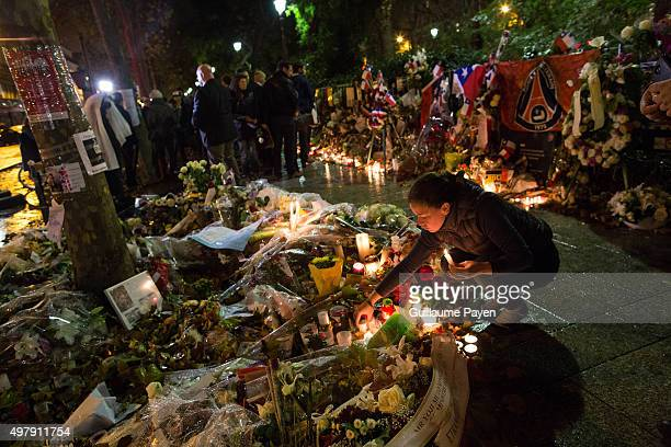 People light candles at a makeshift memorial in front of 'Le Bataclan' concert hall in Paris on November 19 in the 11th district of Paris Islamic...