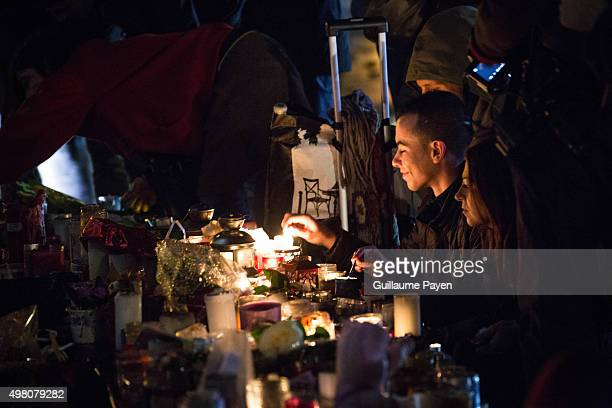 People light candles at a makeshift memorial in front of 'Monument à la république' in the 11th district of Paris Islamic State jihadists claimed...