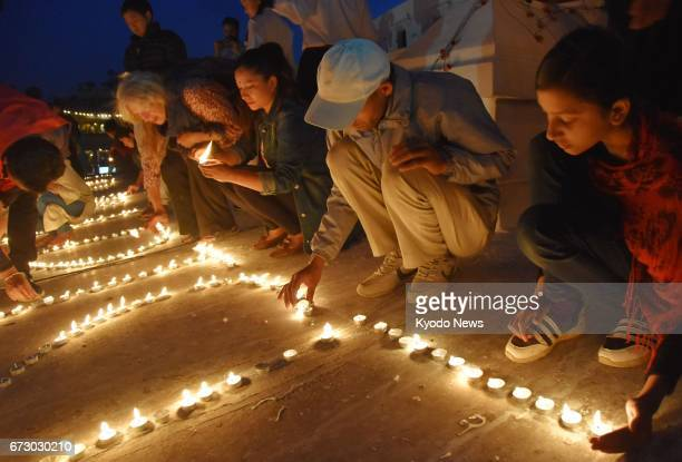 People light candles at Boudhanath Stupa in Kathmandu Nepal on April 25 the second anniversary of a devastating earthquake that killed about 9000...