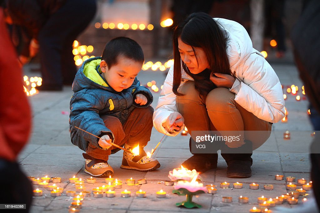 People light candles at Guangren Temple on February 17, 2013 in Xi an, China. The Chinese Lunar New Year of Snake also known as the Spring Festival, which is based on the Lunisolar Chinese calendar, is celebrated from the first day of the first month of the lunar year and ends with Lantern Festival on the Fifteenth day.