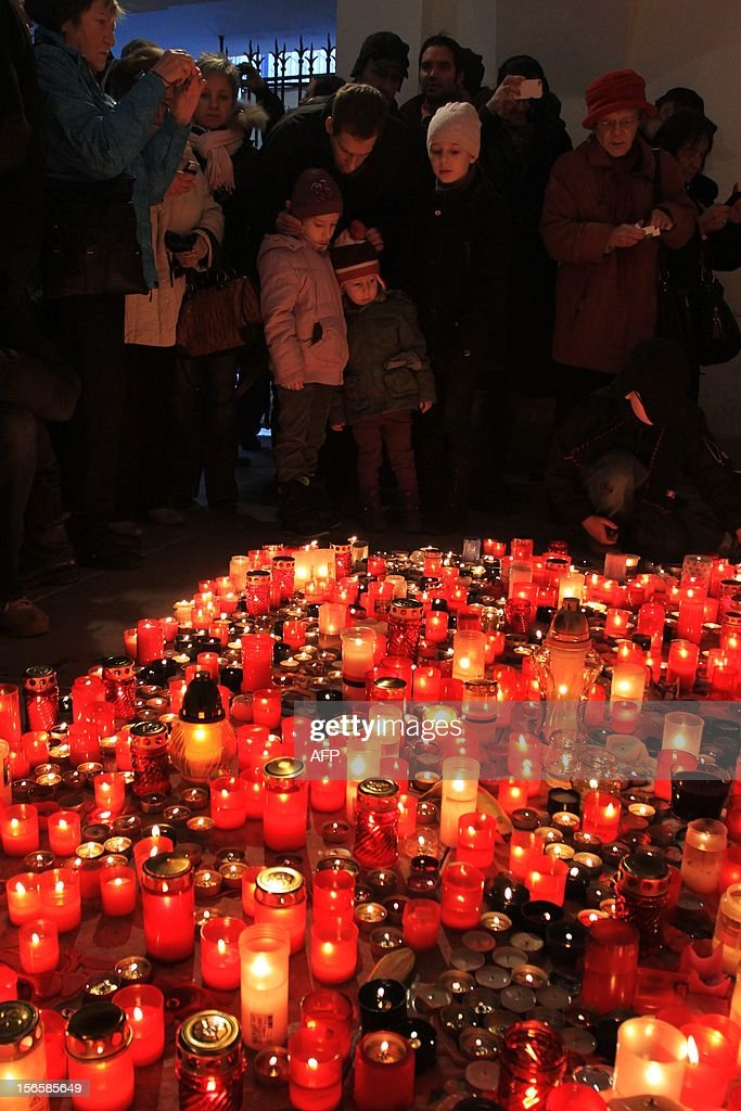 People light candles at Narodni street where in 1989 students clashed with the communist police on November 17, 2012 in Prague. Some twenty thousand people protested today against the government of the Czech Republic.