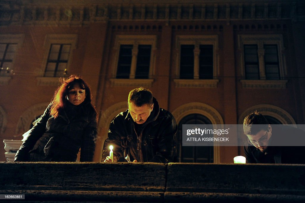 People light candles at the bank of Danube River in Budapest near the Chain Bridge, the oldest Hungarian bridge on February 25, 2013 during a memorial day for victims of communist dictatorships. AFP PHOTO / ATTILA KISBENEDEK