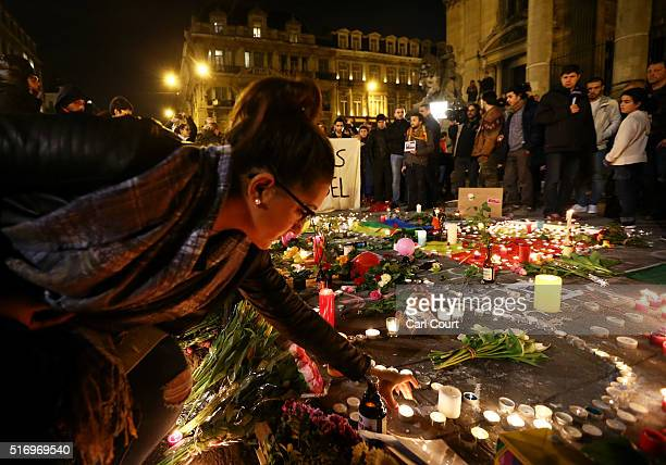 People light candles at the Place de la Bourse following today's attacks on March 22 2016 in Brussels Belgium At least 31 people are thought to have...