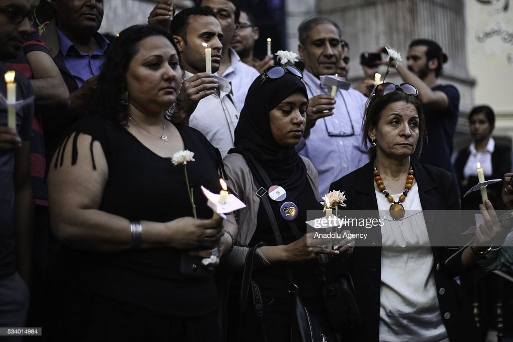 People light candles during a commemoration ceremony for the 66 victims of EgyptAir flight MS804 crash in front of the association of journalists building in Cairo, Egypt on May 24, 2016.