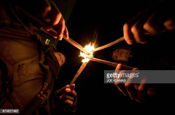People light candles during a rally under the slogan 'Our ministries not in the hands of rightwing extemists' on 15 November 2017 outside the...