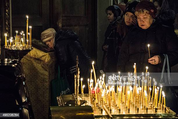 People light candles during a requiem in memory of the victims of the plane crash in Kazan Cathedral on November 1 2015 in St Petersburg Russia...