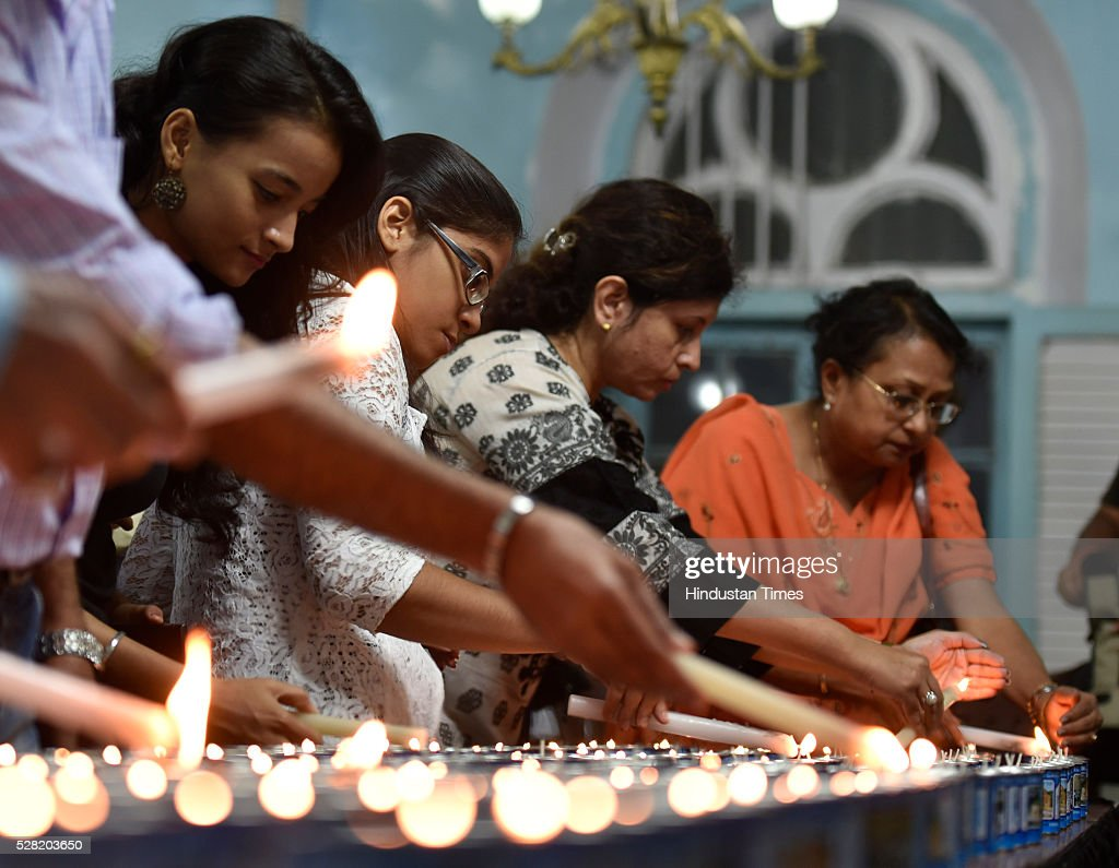 People lights the candle during a special Memorial Service for Holocaust Memorial Day organized by The Jewish Community at the Keneseth Eliyahoo Synagogue, Fort on May 4, 2016 in Mumbai, India. Holocaust Memorial Day or Holocaust Remembrance Day may refer to a number of world-wide commemorations of the Holocaust taking place during World War II. The candles commemorate the six million Jews murdered by the Nazi regime during the Holocaust.