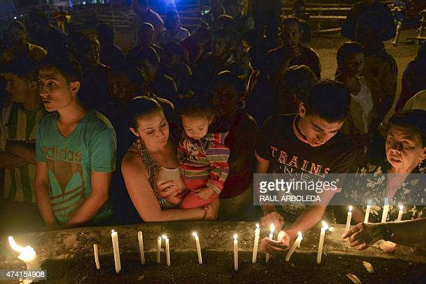 People light candles during a vigil for the victims of a landslide in the Salgar Municipality Antioquia department Colombia on May 20 2015 A massive...