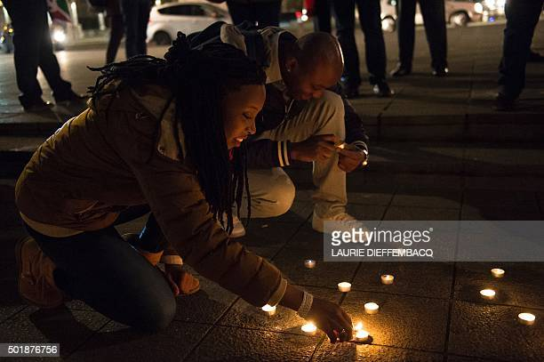 People light candles during a vigil held to call for an end of the killings in Burundi on December 18 in Brussels Small destitute Burundi a central...