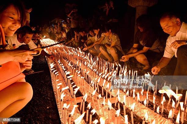 People light candles during the Candle Festival held at the approach of the Okunoin of the Mount Koya Kongobuji Temple on August 13 2015 in Koya...