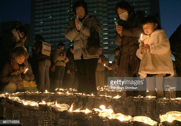 People light candles for the victims to mark the 20th anniversary of the Great Hanshin Earthquake on January 17 2015 in Kobe Hyogo Japan Memorial...