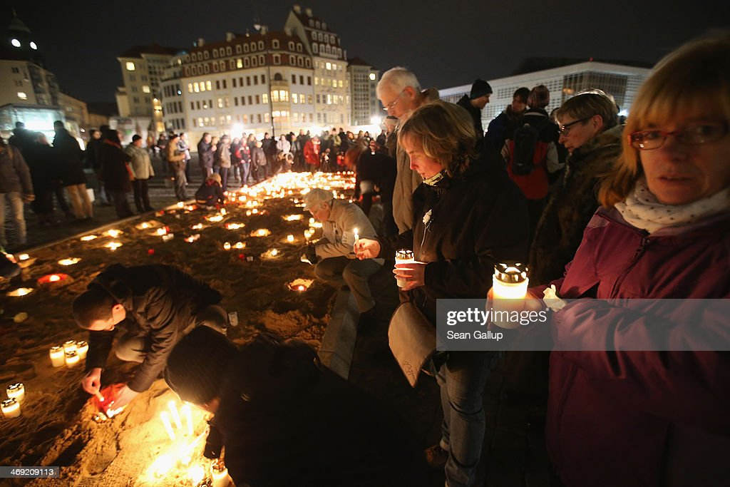 People light candles in front of the Frauenkirche church in the city center as a statement against neo-Nazis on the 69th anniversary of the World War II firebombing of the city by the Allies on February 13, 2014 in Dresden, Germany. Neo-Nazis from across Germany have used the anniversary to parade in Dresden in recent years, though a strong, local grass movement against them has prevented their marches and this year led to the cancellation of a neo-Nazi gathering.
