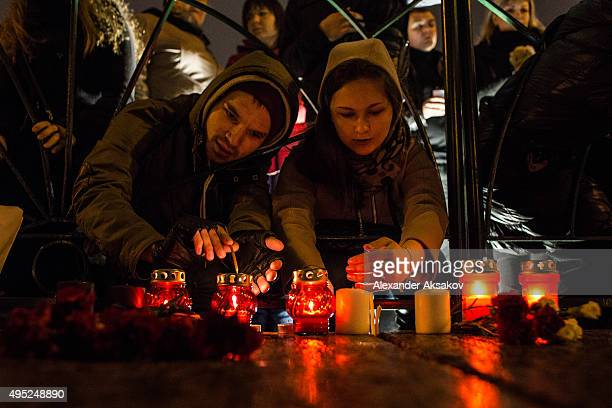 People light candles in the memory of the victims of Airbus A321 crash at the Palace Square on November 1 2015 in St Petersburg Russia A Russian...
