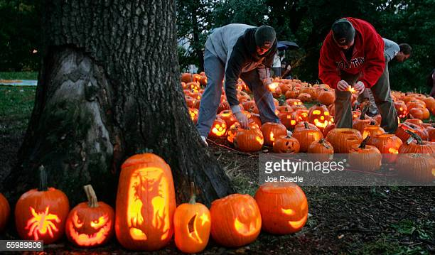 People light candles inside carved pumpkins during the Life is good Pumpkin Festival 2005 October 22 2005 at the Boston Common in Boston...