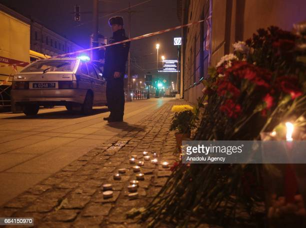 People light candles near the area after an explosion at a subway station in St Petersburg Russia on April 3 2017 A blast hit a train carriage...