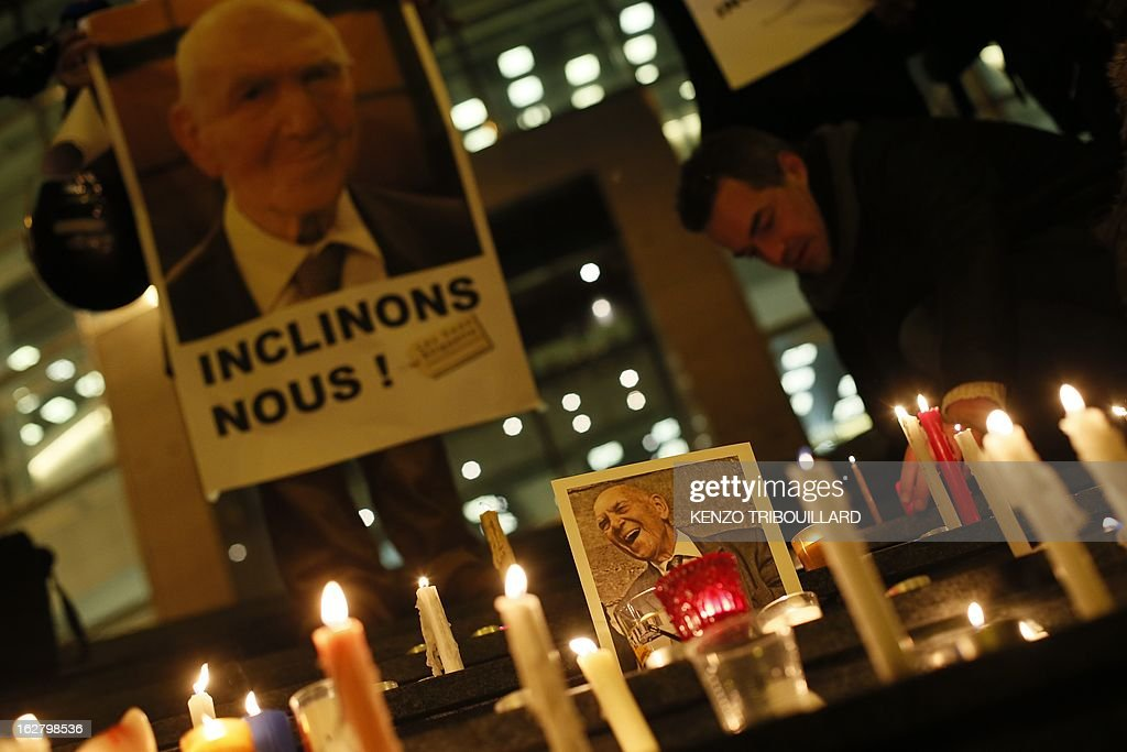 People light candles on February 27, 2013 in Paris, during a rally to pay homage to French resistance hero and Holocaust survivor Stephane Hessel who has died today at the age of 95. The career diplomat was already celebrated as one of the last living heroes of the 20th century when, as a nonagenarian, he became the unlikely godfather of youth protest movements such as 'Occupy Wall Street' and Spain's 'Indignados'.