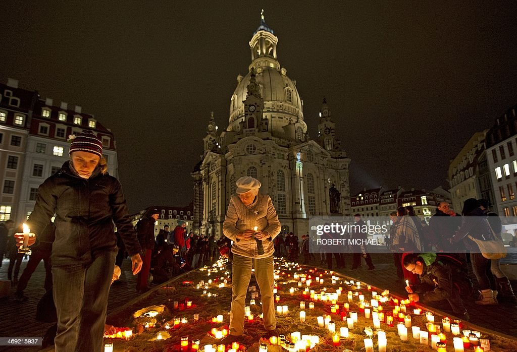 People light candles to commemorate the 69nd anniversary of the bombing of Dresden on February 13, 2014 in front of the Frauenkirche (Church of Our Lady) in Dresden, eastern Germany, against right-wing extremism as residents of Dresden commemorate the 69nd anniversary of the bombing of Dresden. A massive bombing raid by Allied forces on Dresden beginning on February 13, 1945 sparked a firestorm that destroyed much of the historical centre of the city.