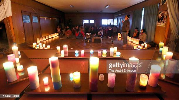 People light candles to commemorate the victims a day before the fifth anniversary of the Great East Japan Earthquake and following tsunami on March...