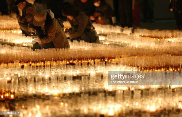 People light candles to commemorate the victims of the Magnitude 90 earthquake and tsunami two years ago on March 10 2013 in Nagoya Aichi Japan 15...
