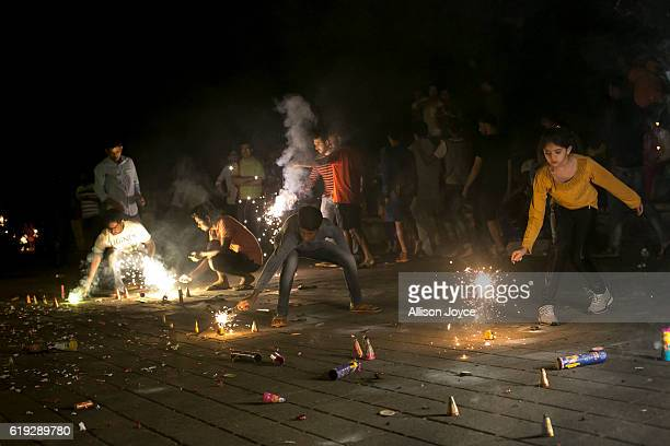 People light fire crackers as Indians celebrate the annual festival of Diwali on October 30 2016 in Mumbai India Diwali the festival of lights is one...