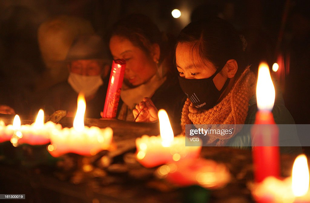 People light the candles greeting for God on February 10, 2013 in Zhangye, Gansu Province of China. The Chinese Lunar New Year of Snake also known as the Spring Festival, which is based on the Lunisolar Chinese calendar, is celebrated from the first day of the first month of the lunar year and ends with Lantern Festival on the Fifteenth day.