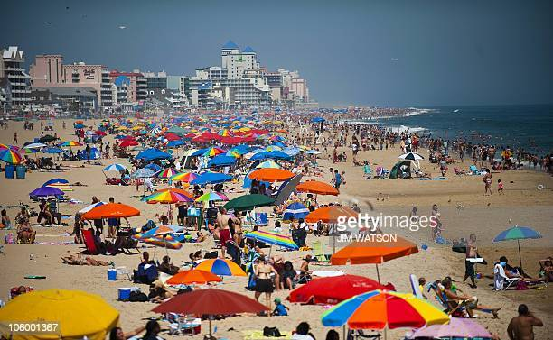 People line the beach in Ocean City Maryland on August 29 2010 AFP PHOTO/Jim WATSON