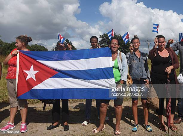 People line the Carretera Central to see the convoy carrying the urn with the ashes of Cuban leader Fidel Castro on December 1 during its fourday...