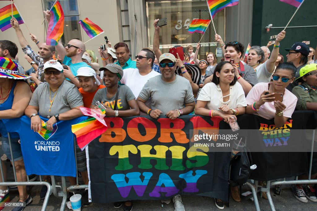 People line the sidewalk during the 46th annual Gay Pride march June 26, 2016 in New York. New York kicked off June 26 what organizers hope will be the city's largest ever Gay Pride march, honoring the 49 people killed in the Orlando nightclub massacre and celebrate tolerance. / AFP / the 46th / Bryan R. Smith