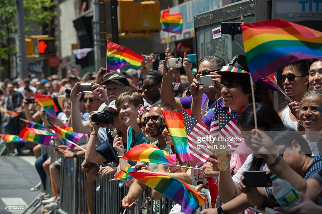 People line the sidewalk to see the 46th annual Gay Pride march June 26, 2016 in New York. New York kicked off June 26 what organizers hope will be the city's largest ever Gay Pride march, honoring the 49 people killed in the Orlando nightclub massacre and celebrate tolerance. / AFP / the 46th / Bryan R. Smith