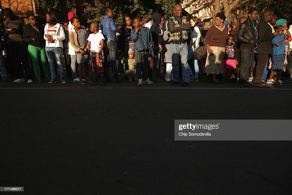 People line the street outside of the Mediclinic Heart Hospital where former South African President Nelson Mandela is being treated June 25, 2013 in Pretoria, South Africa. South African President Jacob Zuma confirmed on June 23 that Mandela's condition has become critical since he was admitted to the hospital over two weeks ago for a recurring lung infection.