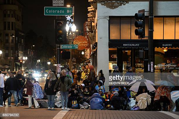 People line the streets as they await the start of the 128th Rose Parade in Pasadena California January 2 2017 The Rose Parade also known as the...