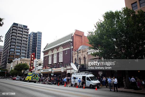People line up and wait for US President Barack Obama outside the at the Paramount Theatre on Congress Ave on July 10 2014 in Austin Texas Obama is...
