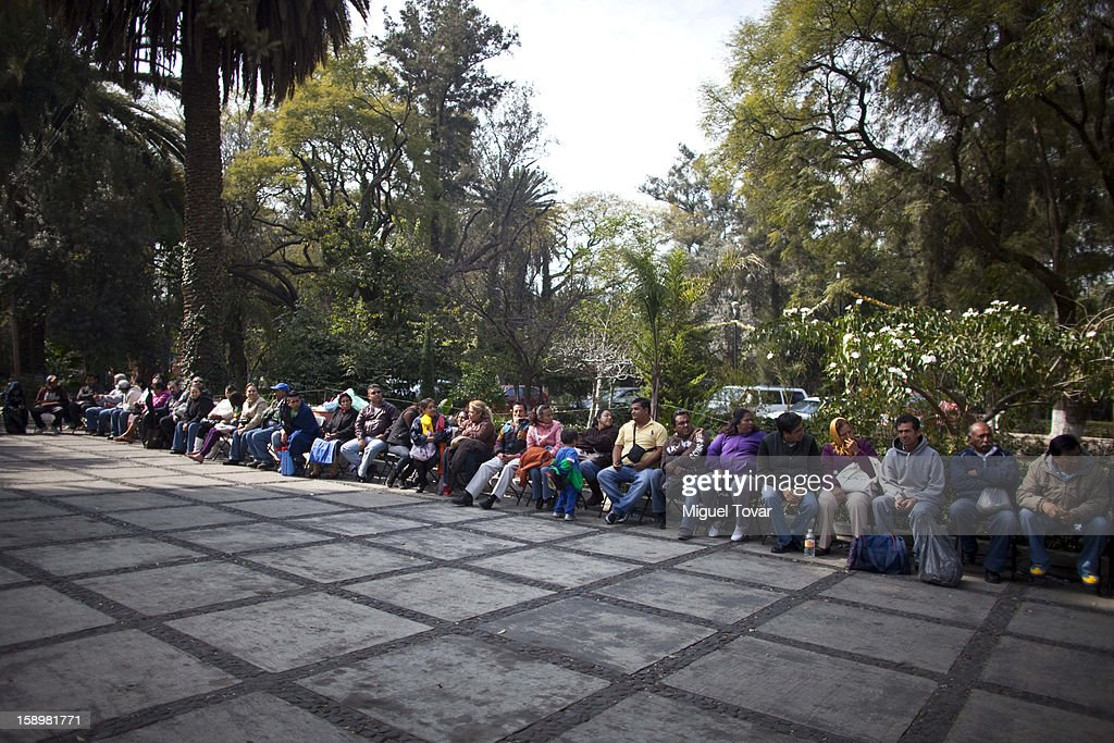 People line up as they wait to exchange firearms on January 04, 2013 in Mexico City, Mexico. More than a thousand weapons have been changed for a tablet, bicycles or money in a low-income neighborhood in the capital, according to authorities.