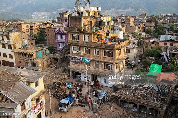 People line up at a truck for drinking water next to destroyed and damaged buildings in Sankhu Kathmandu Valley Nepal on Monday May 25 2015 Nepal's...