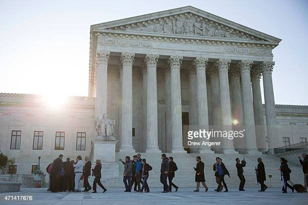 People line up at Supreme Court to hear oral arguments in the Obergefell v Hodges case April 28 2015 in Washington DC On Tuesday the Supreme Court...