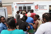 People line up for free meals provided by the Salvation Army on Friday September 2 2005 in Gulfport Mississippi President Bush toured this...